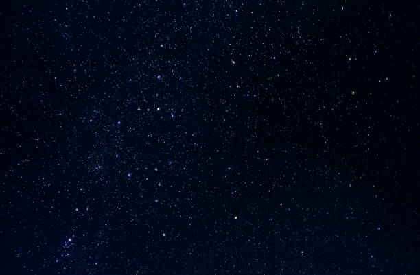 Dark night sky with plenty of stars as background stock photo