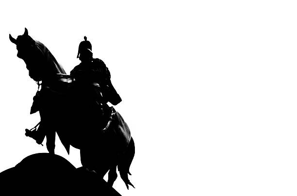 dark night with his horse looking down - knight on horse stock photos and pictures