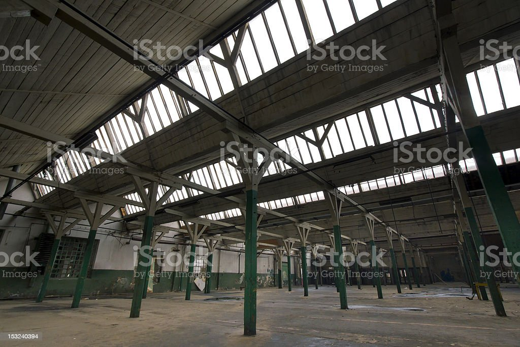 dark, old factory hall with roof windows royalty-free stock photo