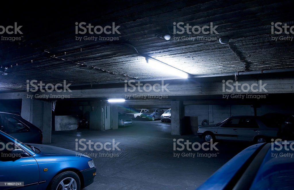 Dark old parking garage stock photo