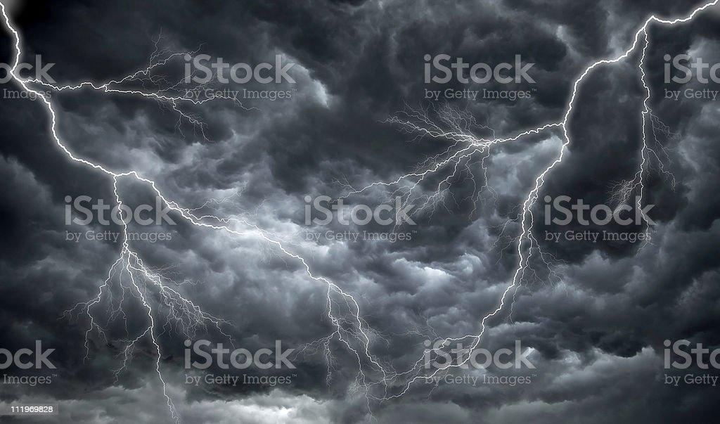 Dark, ominous rain clouds and lightning stock photo