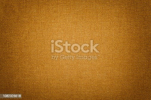 istock Dark orange background from a textile material. Fabric with natural texture. Backdrop. 1082325518