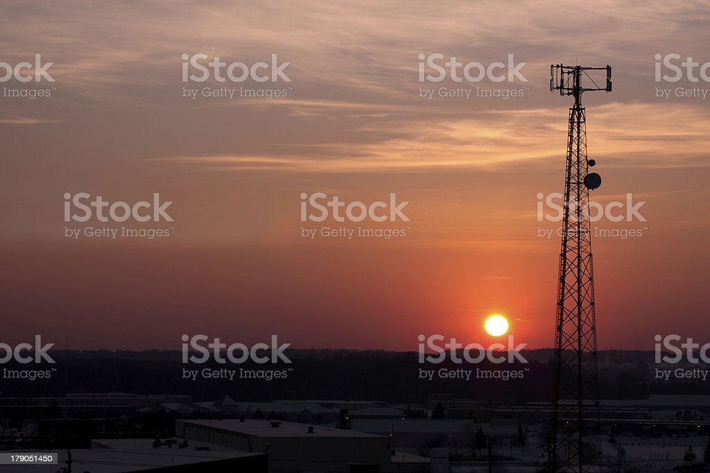Dark Orange Cell Phone Tower Silhouette stock photo