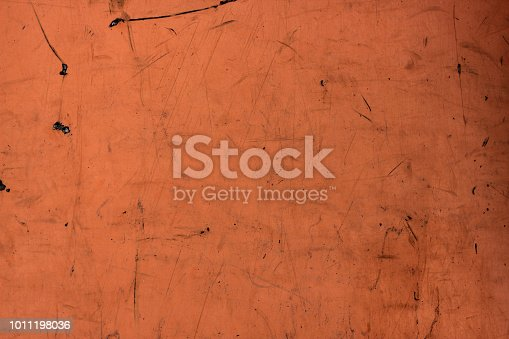 Dark orange paint plywood wall background. Dirty and scratched tera-cotta wallpaper, city building backdrop with place for text