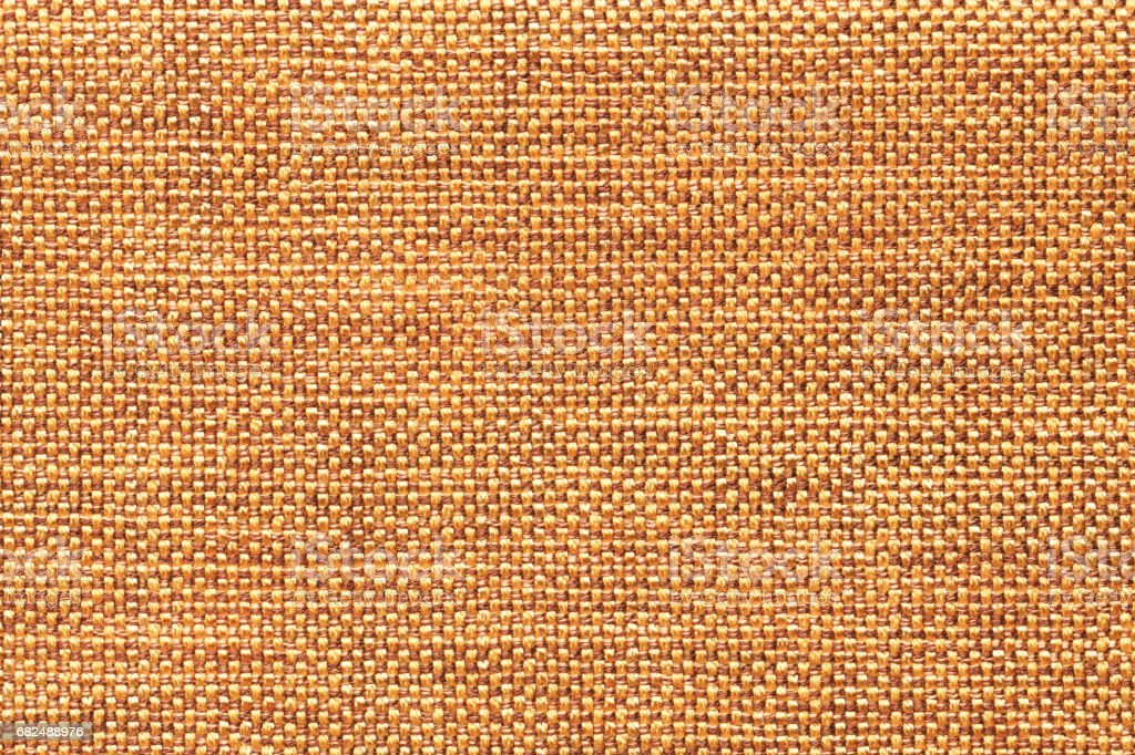 Dark orange textile background with checkered pattern, closeup. Structure of the fabric macro. Стоковые фото Стоковая фотография