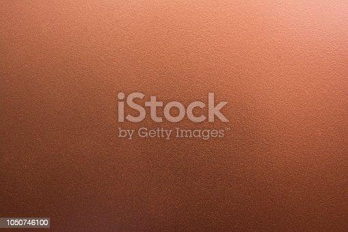 istock Dark pale bronze texture background. Copper texture 1050746100
