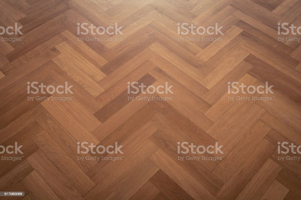 dark parquet floor, wooden floor - parquet flooring herringbone stock photo