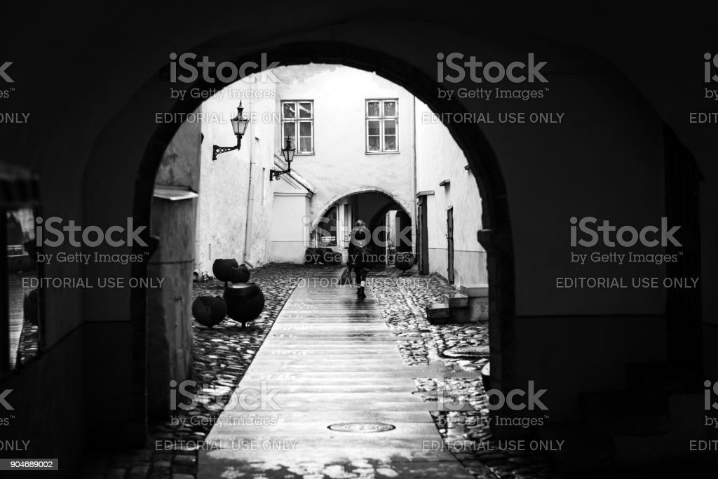 Dark passage in Tallinn old town stock photo