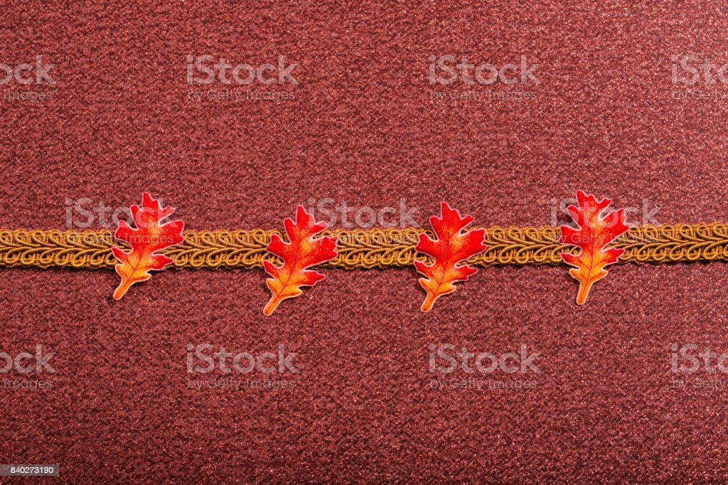 Gold Ribbon on Dark Pink background with leaves