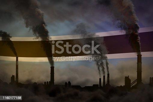 istock Dark pollution, fight against climate change concept - plant chimneys dense smoke on Botswana flag background - industrial 3D illustration 1160177158