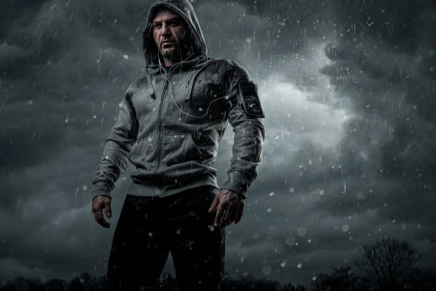 dark portrait of a runner in the rain - combat sport stock pictures, royalty-free photos & images