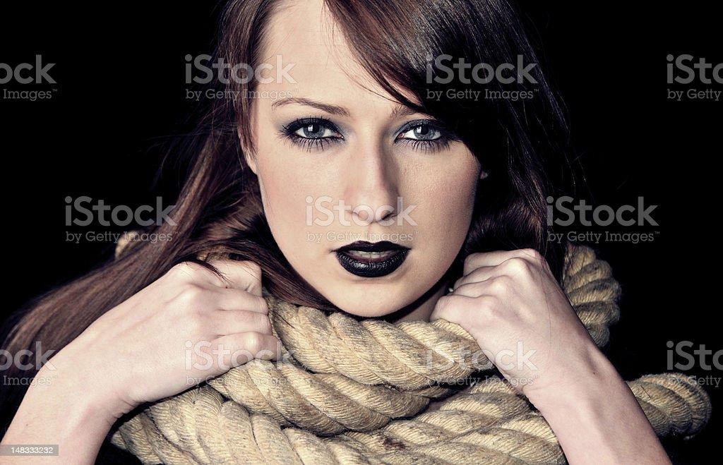 Dark portrait of caucasian brunette royalty-free stock photo