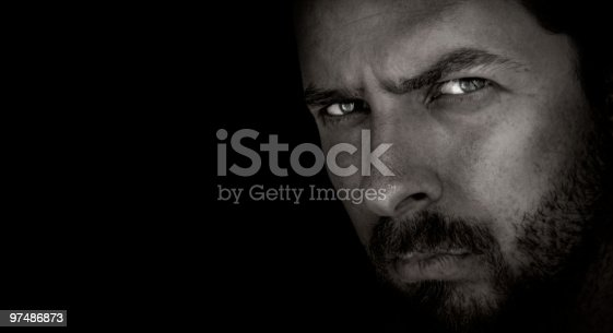 istock Dark portrait of scary man with evil eyes 97486873