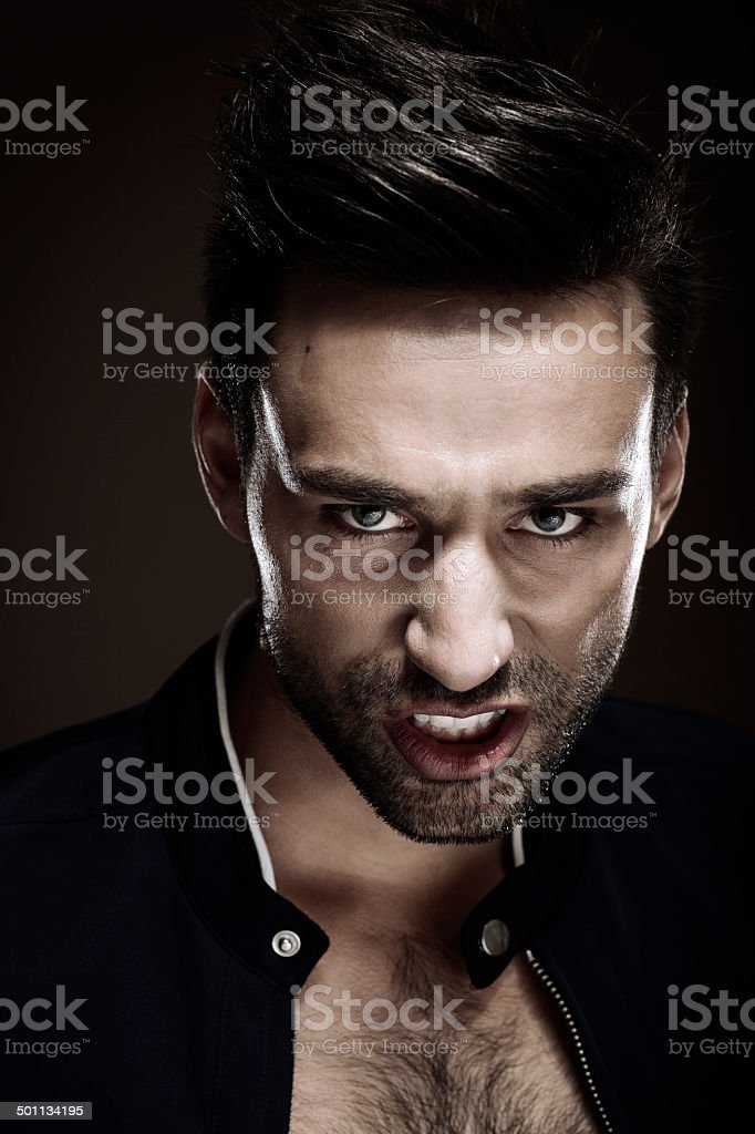 Dark Portrait Of Young Serious Man royalty-free stock photo