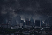 Dark rain cloud with lightning storm in the city