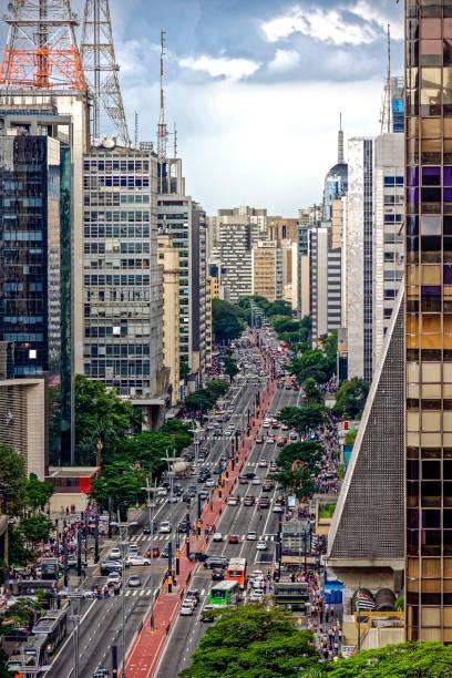 Dark rain clouds over Paulista avenue stock photo