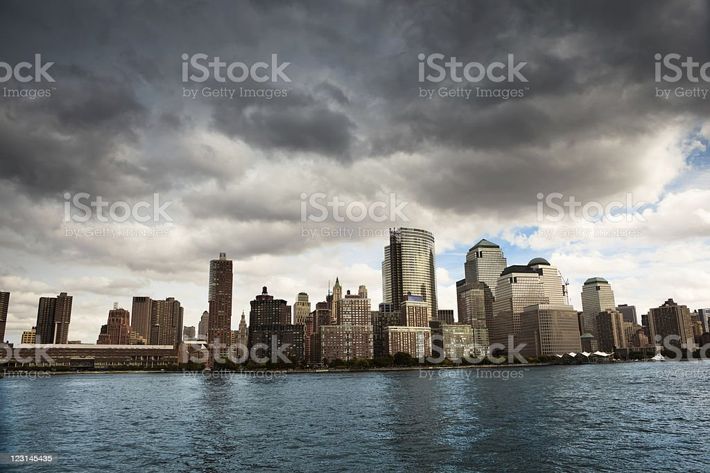 Dark rain clouds over World Trade Center buildings royalty-free stock photo