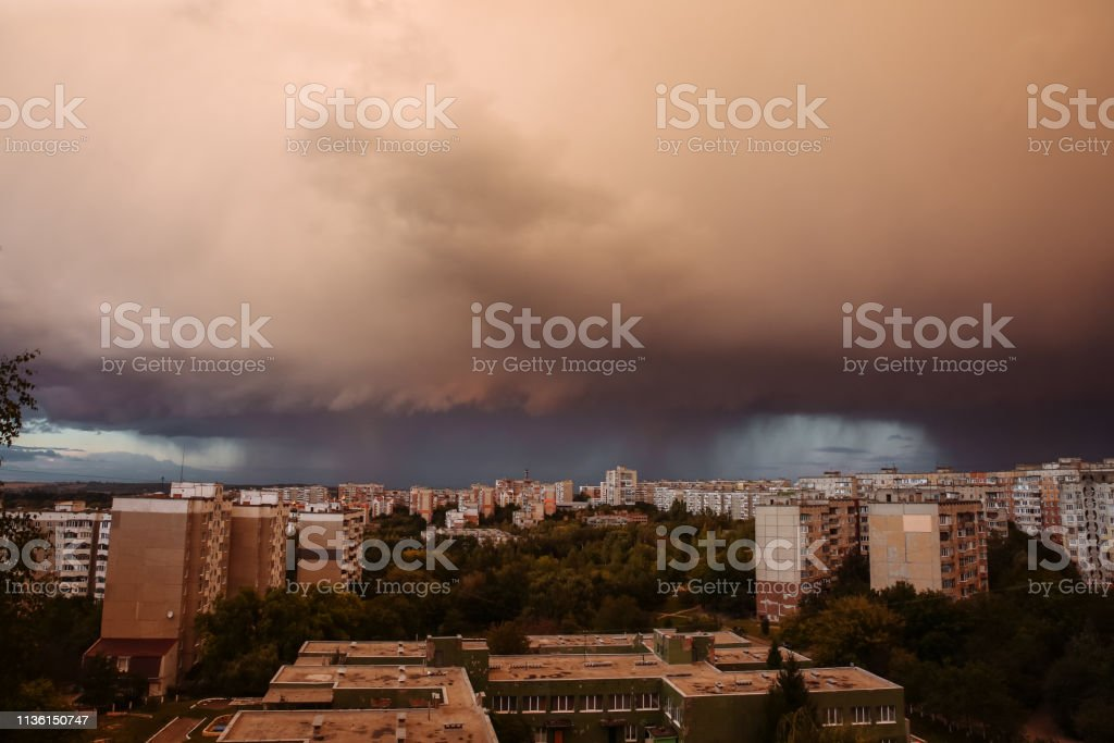 Dark rainy clouds. Stormy weather. Beautiful landscape. Nature...