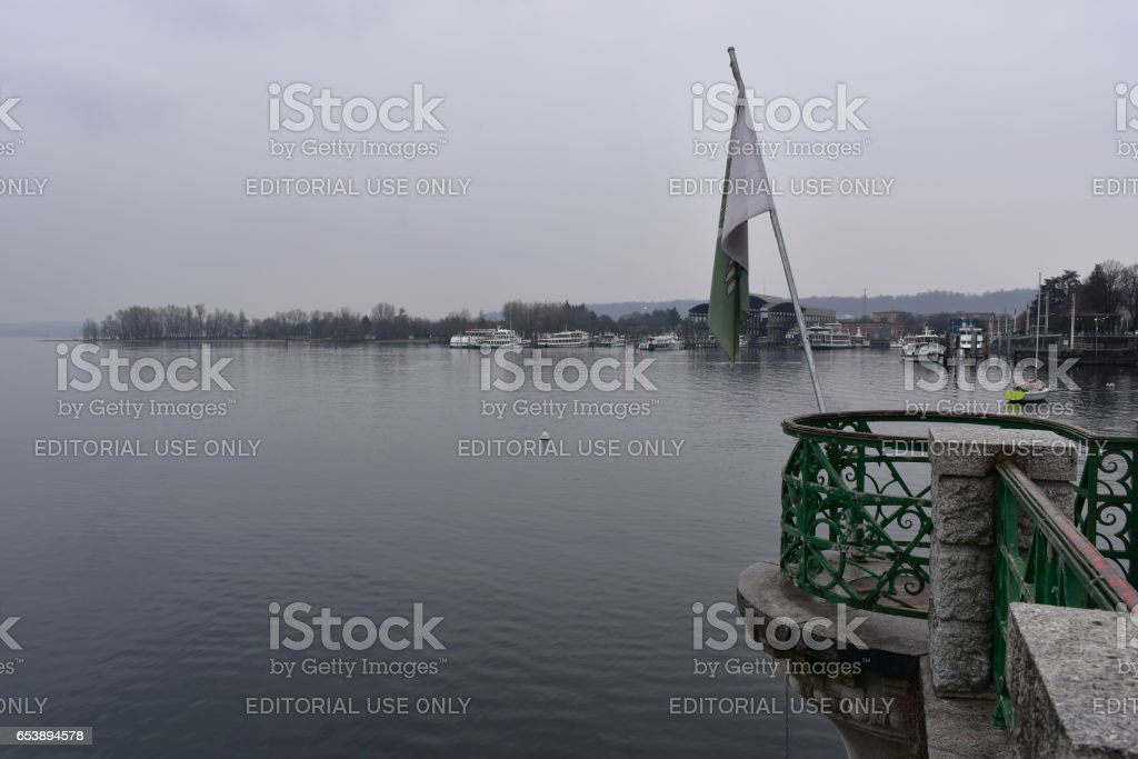 Arona, Italy - February 2, 2017: Dark rainy morning by Lago Maggiore stock photo