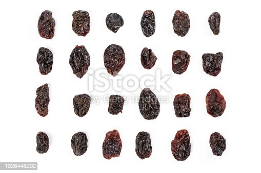 Dark raisins isoalted on white background