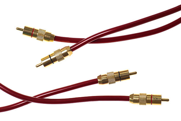 Dark red audio cables isolated on white stock photo