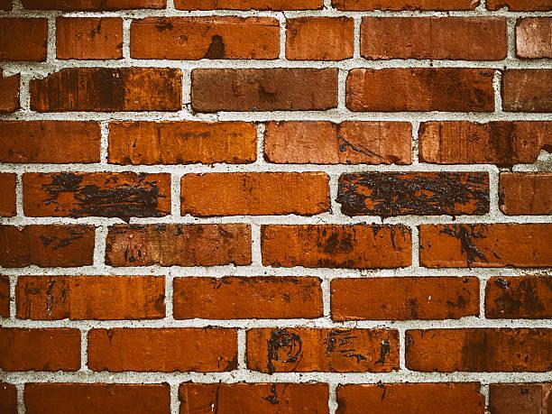 Dark red brick wall stock photo