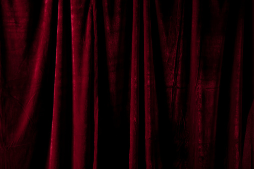 Dark Red Curtain Folded at a Theater