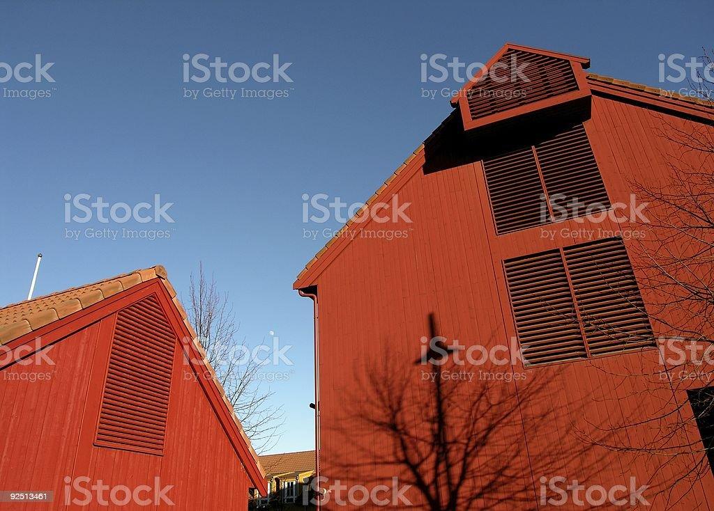 Dark Red Home Sky Blue royalty-free stock photo