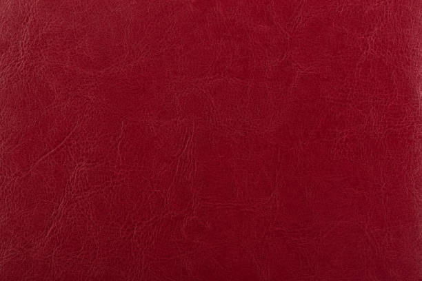 dark red leather surface as a background, leather texture. skin texture concept. - couro imagens e fotografias de stock