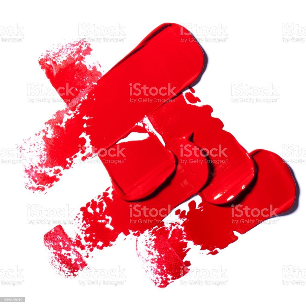 Dark red lipstick on white background. stock photo