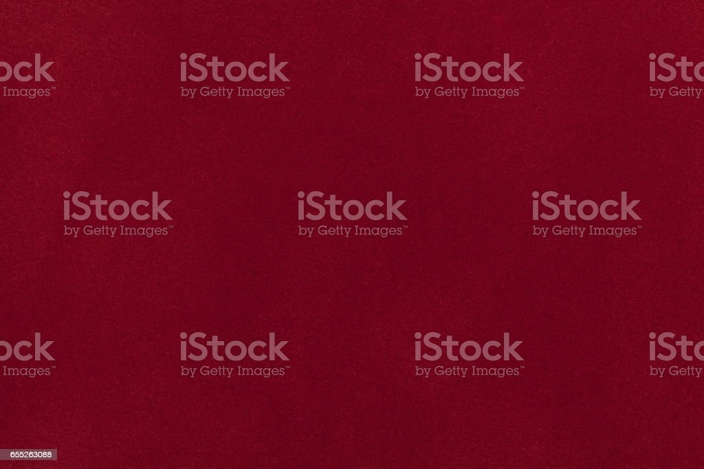 Dark red suede fabric closeup. Velvet texture. stock photo