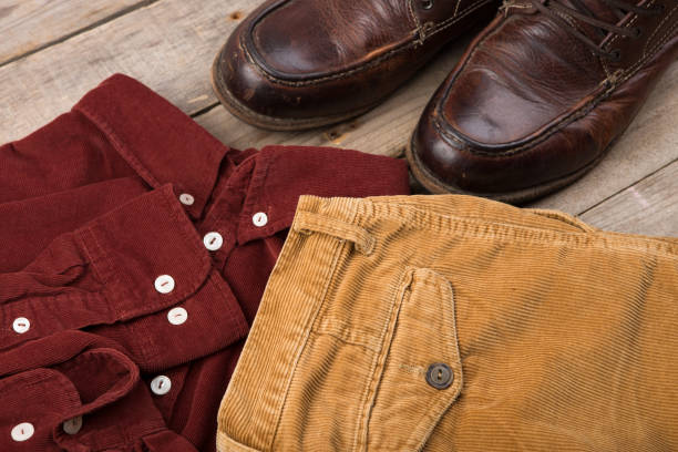 dark red velveteen shirt on the wooden background - corduroy stock pictures, royalty-free photos & images