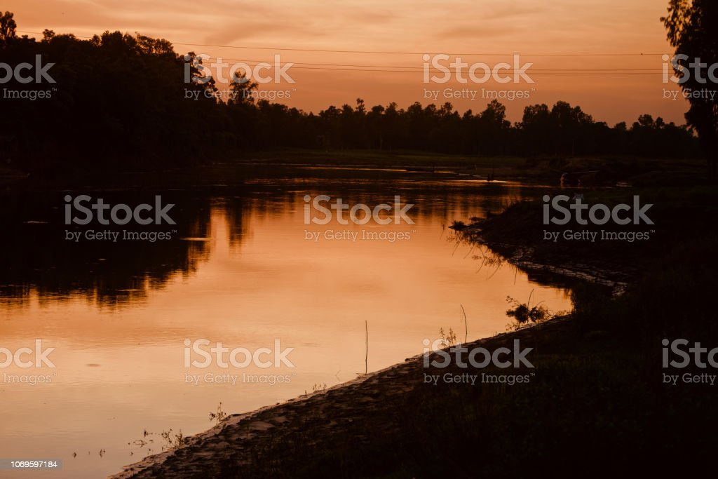 Dark river waters in the evening stock photo
