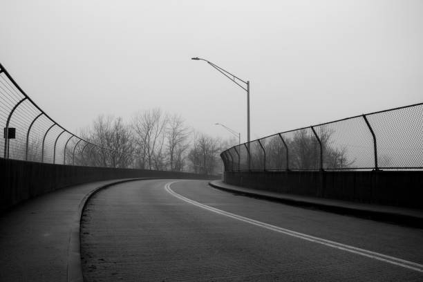 Dark Road Through a Misty Town stock photo