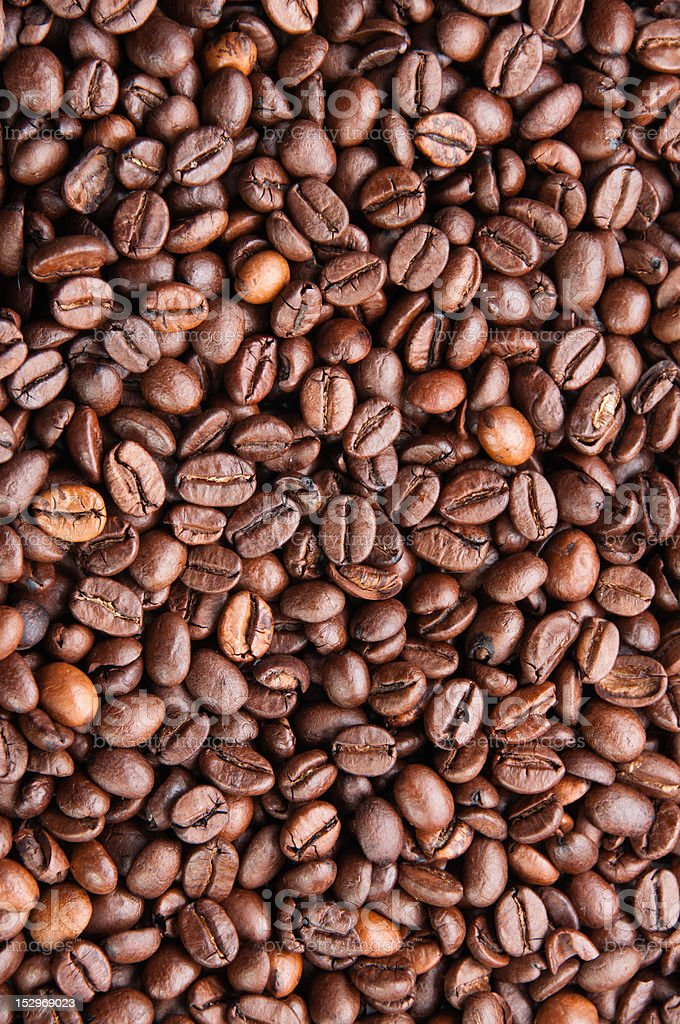 Dark roasted coffee beans texture stock photo