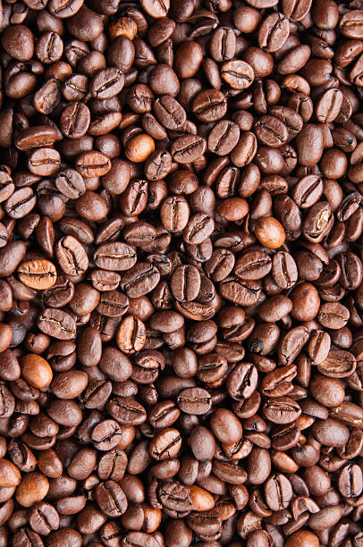 Dark roasted coffee beans texture