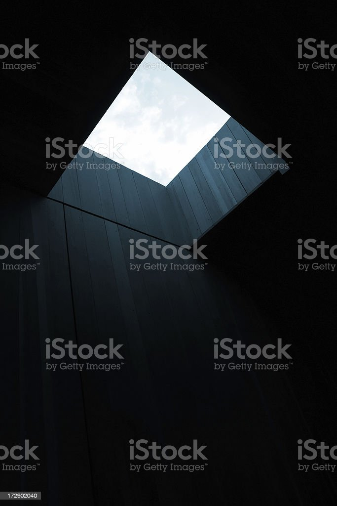 Dark room with opening to sky. stock photo