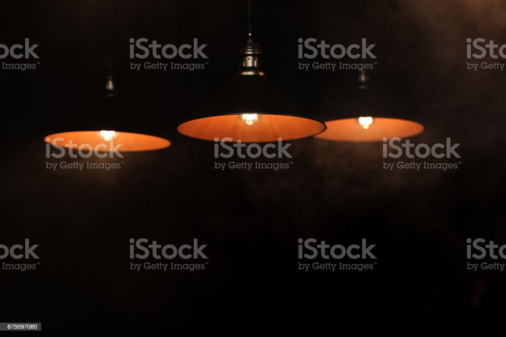 dark room with three lamps stock photo