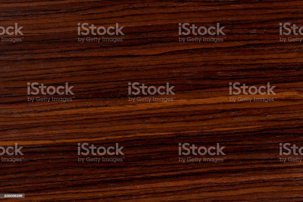 Dark rosewood background, natural wooden texture with patterns stock photo