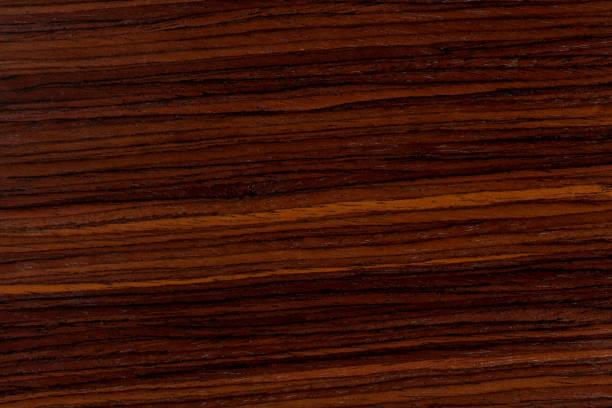 dunkles rosenholz hintergrund, natürliche hölzerne struktur mit muster - mahagoni braun stock-fotos und bilder