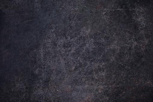 Overhead view of Dark rusty metal surface