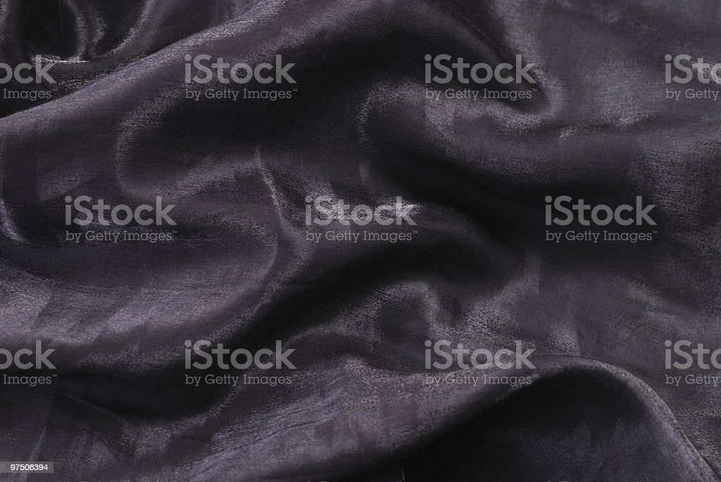 Dark shiny folded textile royalty-free stock photo