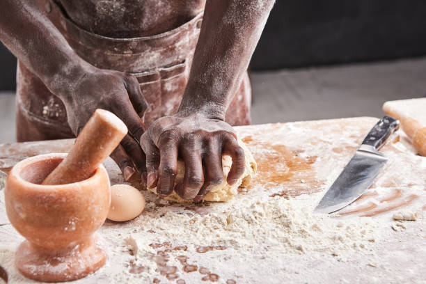Dark skin baker man kneads dough in the kitchen pastry chef prepares picture id1221193260?b=1&k=6&m=1221193260&s=612x612&w=0&h=uld1i0bsyqruxmvj7wqb11vuqrpwrll drznwtnxdfw=