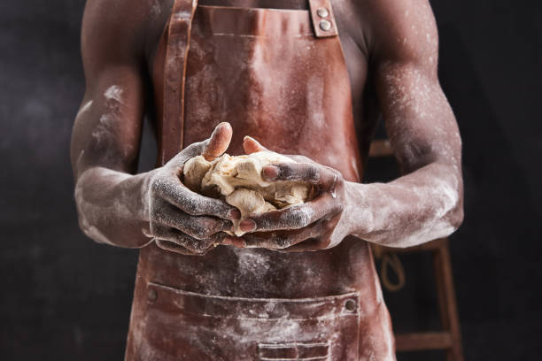 Dark skin baker man kneads dough in the kitchen pastry chef prepares picture id1221193397?b=1&k=6&m=1221193397&s=612x612&w=0&h=0ftd98ajflv9txc5nbvd tiezbdhzridt3qoyv0lvs0=