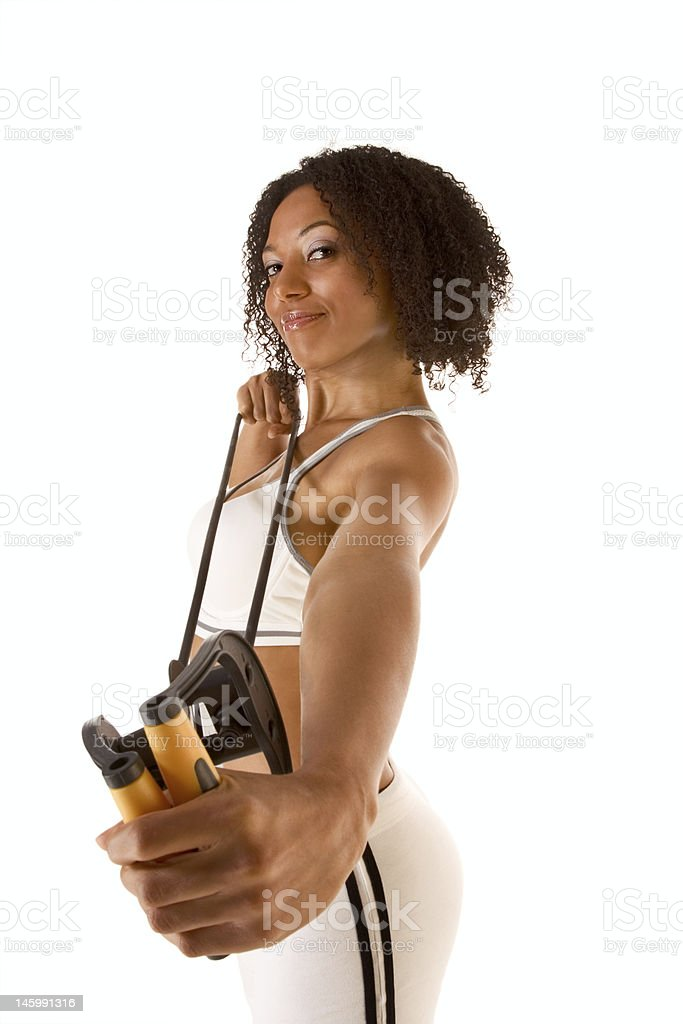 Dark skinned female exercising with Resistance Band (selective focus) royalty-free stock photo