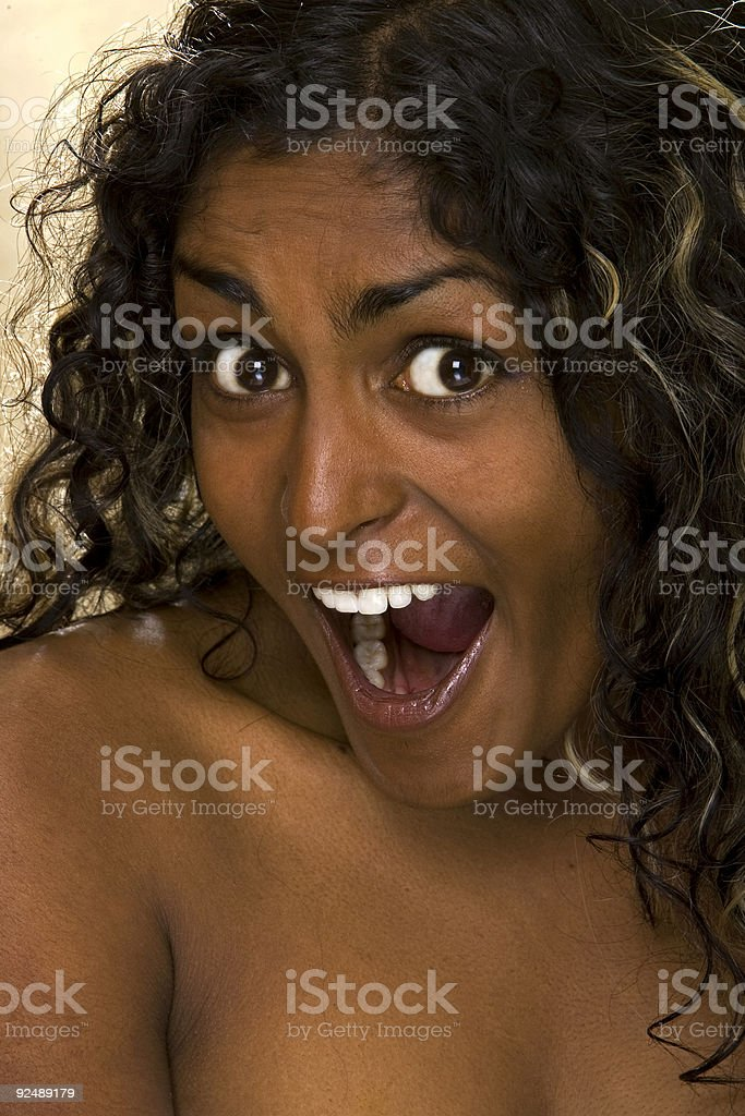 Dark skinned girl has a surprised face. royalty-free stock photo