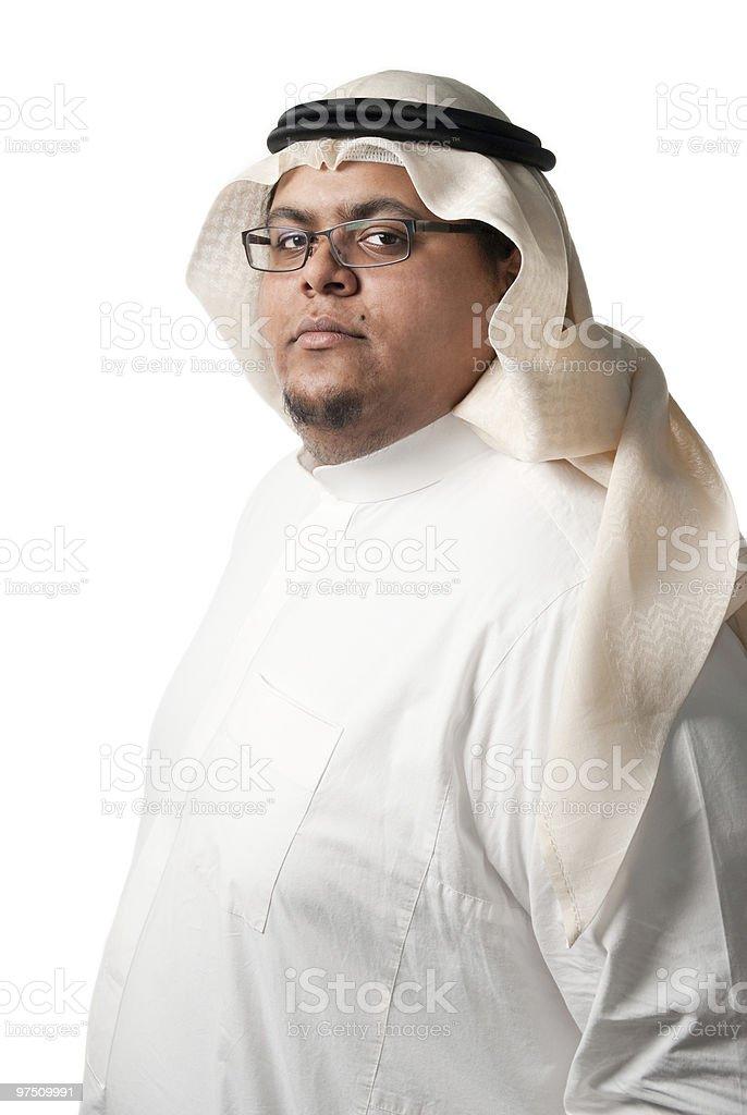 Dark skinned Saudi Arabian young man wearing traditional clothes royalty-free stock photo