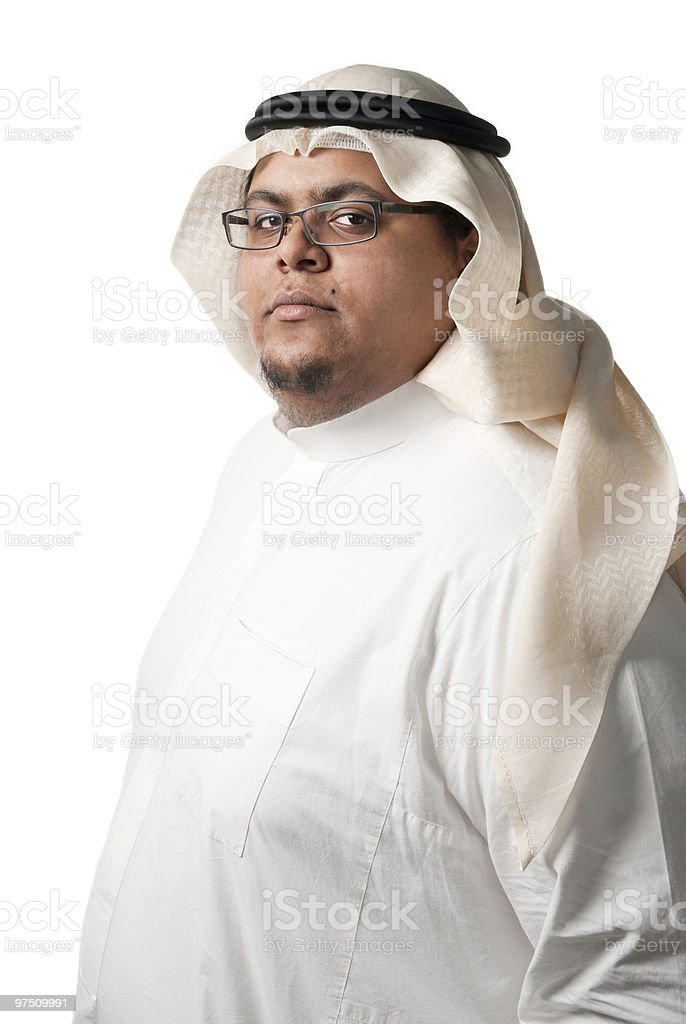 Dark skinned Saudi Arabian young man wearing traditional clothes stock photo