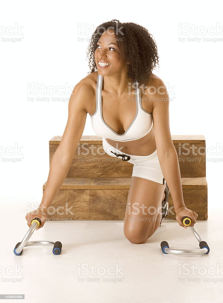 Dark skinned woman with push up bars royalty-free stock photo