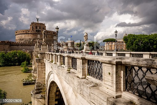 Rome, Italy, May 29 -- A dark sky looms over Castel Sant'Angelo near the Vatican and St. Peter's Basilica. Built around 123 AD as a sepulcher for Emperor Hadrian and his family, the current Castel Sant'Angelo was used as a fortress, prison and refuge by the Popes, connected to the Vatican by a long narrow narrow corridor called 'Passetto'. It is currently owned by the Italian state and is used for visits and cultural events. Image in HD format.